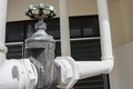 Close up  Water valve, and pipe outside a building Royalty Free Stock Photo