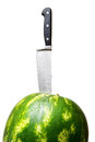 Close-up of watermelon with knife. Stock Photos