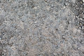 Close up of wet gray gravel road or ground Royalty Free Stock Photo