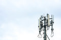Close up white color antenna repeater tower on blue sky Royalty Free Stock Photo