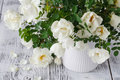 Close up of white flowers on wooden table. Royalty Free Stock Photo