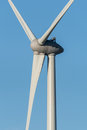 Close up of a wind turbine against a blue sky. Royalty Free Stock Photo