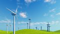 Close up of wind turbines on green hills Royalty Free Stock Photo
