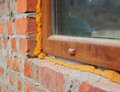 Close up on window insulation with foam if you replace your windows and doors you will want to insulate around the opening Royalty Free Stock Photo