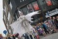 Close up of winged lady who is part of the street theater group close act hoogeveen netherlands august hoogeveen netherlands Stock Photo