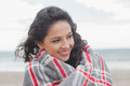 Close up of a woman covered with blanket at beach young the Stock Photos