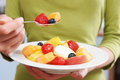 Close Up Of Woman Eating Bowl Of Fresh Fruit Royalty Free Stock Photo
