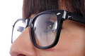 Close-up of a woman eye with black glasses Royalty Free Stock Photo