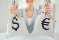 Close up of woman hands holding money bags Royalty Free Stock Photo