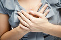 Close up woman having chest pain breast pain