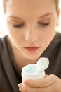 Close up of woman holding facial cleanser women Stock Images