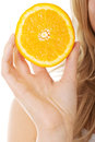 Close up on woman holding an orange Royalty Free Stock Photo