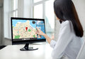 Close up of woman with navigator map on computer Royalty Free Stock Photo