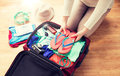 Close up of woman packing travel bag for vacation Royalty Free Stock Photo