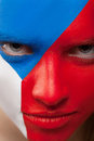 Close up of woman painted face with red blue white colors Stock Photography