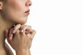 Close-up of woman praying with joining hands Royalty Free Stock Photo