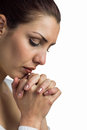 Close-up of woman praying with joining hands and eyes closed Royalty Free Stock Photo