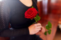 Close up of woman with roses at funeral in church Royalty Free Stock Photo