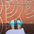 Close up of a Woman's Blue Slippers Buddhist Walking on Street or Ground for Relaxation and Meditation