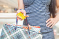 Close-up of woman's hand holding credit card and bags Royalty Free Stock Photo