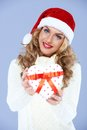 Close up of woman in Santa hat Stock Photos