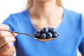 Close Up Of Woman With Spoonful Of Blueberries Royalty Free Stock Photo