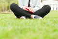 Close-up of woman standing on grass and holding book or diary Royalty Free Stock Photo