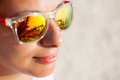 Close up of Woman In Sunglasses With Beach Reflection Royalty Free Stock Photo