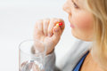 Close up of woman taking medicine in pill Royalty Free Stock Photo