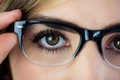 Close-up of woman touching her glasses Royalty Free Stock Photo