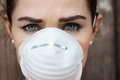 Close up woman wearing a face mask of an unhappy to deal with virus or pollution Stock Photos