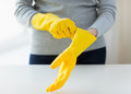 Close up of woman wearing protective rubber gloves