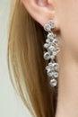Close up of woman wearing shiny diamond earrings beautiful Stock Photo