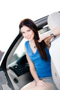 Close up of woman in the white car smiley with door opened Stock Images