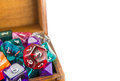 Close up of wooden chest full of dice a small multicolored Stock Photography