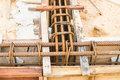 Close up of wooden mold with steel rod forming the foundation beam at construction site Stock Photo