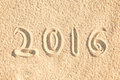 Close up on 2016 written in the sand