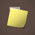 Close up of yellow note paper reminder on brown background
