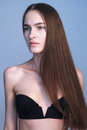 Close up of young beautiful female looking away with pretty long hair and natural make dressed in black bra Stock Photography