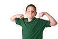 Close up young boy flexing green polo shirt isolated white background Royalty Free Stock Photography