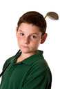 Close up young boy holding golf driver over his shoulder isolated white background Royalty Free Stock Photos