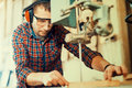 Close up of a young carpenter at work Royalty Free Stock Photo