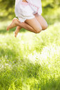 Close Up Of Young Girl Jumping In Summer Field Royalty Free Stock Photo