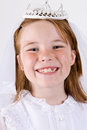Close up young girl smiling her first communion dress veil Stock Photography