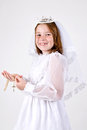 Close up young girl smiling her first communion dress veil holding her rosary beads cross Stock Photo