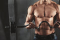 Close up of young muscular man lifting weights Royalty Free Stock Photo