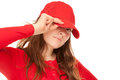 Close up of a young woman with cap portrait in red isolated on white Royalty Free Stock Photos