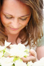 Close up of a young woman with flowers, isolated Stock Photos