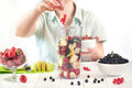 Close up of a young woman prepare to blending fruits and berries Royalty Free Stock Photo