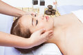 Close up of young woman receiving facial massage at day spa youngwoman Stock Photography